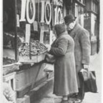 Women and man in front of store