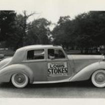 Automobile with political ads on side for Congressman Louis Stokes