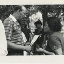 Louis Stokes in conversation with a woman at Welcome