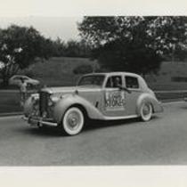Congressman Louis Stokes campaigning in automobile
