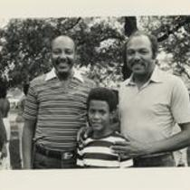 Louis and Carl Stokes with a boy