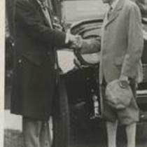 John D. Rockefeller greets Harvey Firestone